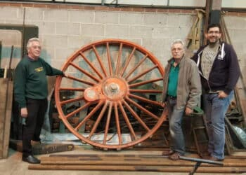 CCT directors Richard Croucher (left), David Bradshaw and Gary Boyd-Hope with the wheel pattern for No. 3840's coupled wheels. The pattern had previously been used to cast the six drivers of No. 2999 Lady of Legend.