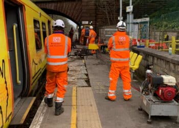 Recovery team getting derailed Merseyrail train back onto the track at Kirkby station