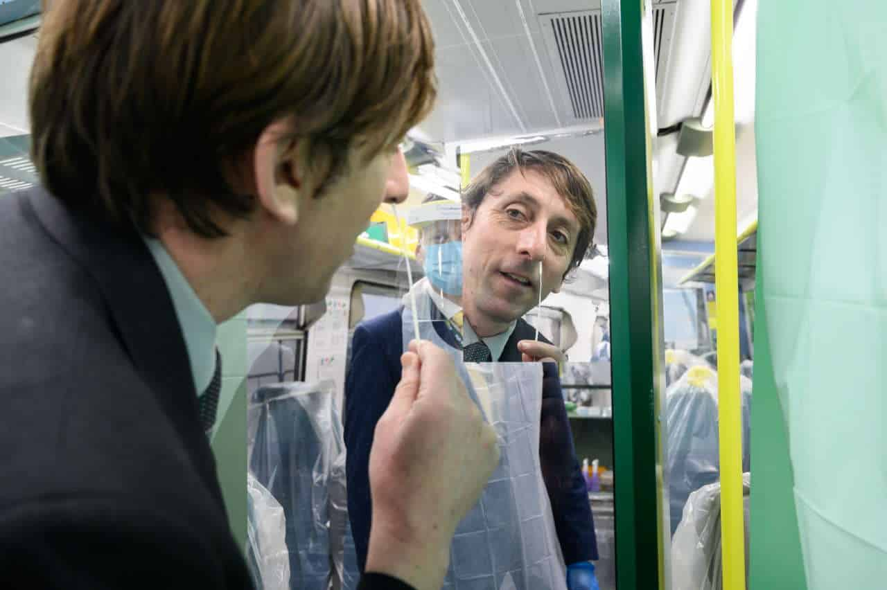 Team leader Jeremy Moss carries out a swab test on board the Southern train at Brighton station