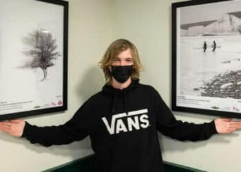 Josh Elphick, Young Landscape Photographer of The Year, at his exhibition in Burgess Hill station's new waiting room