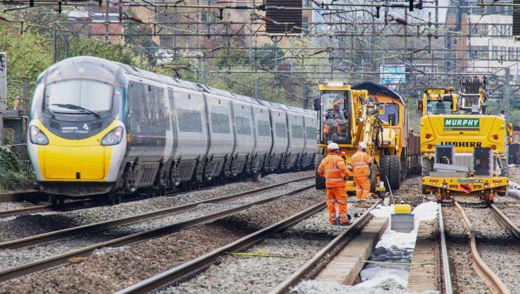 Avanti West Coast train passing Willesden track upgrade worksite March 2021