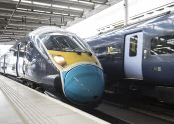 2 trains at a station passing