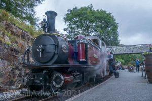 Merddin Emrys stands at Tanybwlch on the Ffestiniog Railway