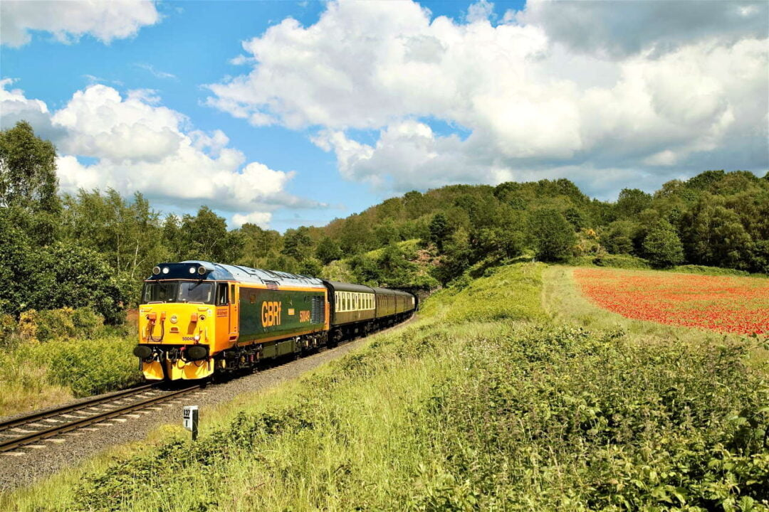 50049 Defiance leaves Bewdley tunnel past the poppy fields with the 1455 Kidderminster-Bridgnorth