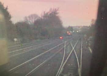 CCTV image from the rear of the train of empty coaches, showing the rail grinding train, travelling towards the junction, on the left
