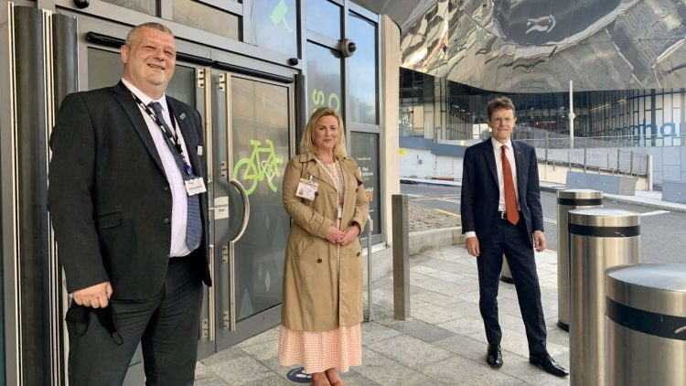 Birmingham New Street railway station cycle pod, L-R Craig Stenning Birmingham New Street station manager, Emma Crowton Transport for the West Midlands, Andy Street Mayor of the West Midlands