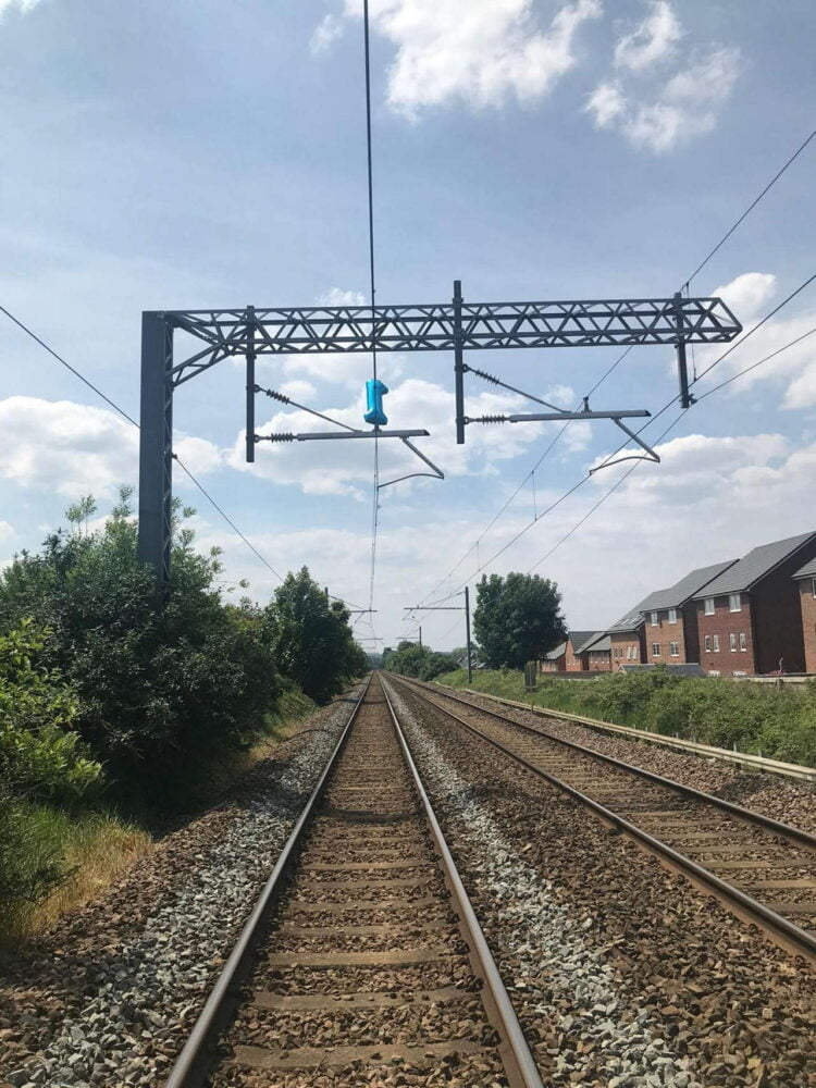 Portrait shot of the helium balloon on the overhead lines at Prescot, Liverpool