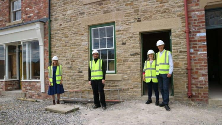 (l-r) Lisa Kaimenas and Connor Emerson of Beamish Museum with Dorothy and John Cornish, Norman's son, in front of No. 2 Front Street terrace. The exhibit, inspired by Norman Cornish's home, is taking shape in Beamish's 1950s Town.