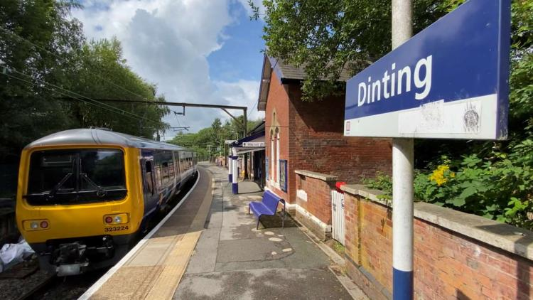 Northern train about to depart Dinting station on the Manchester to Glossop line