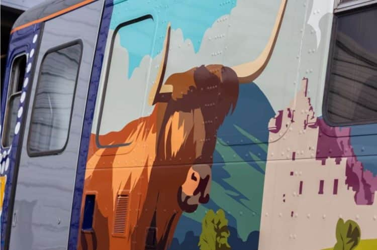 A bull on a side of a train
