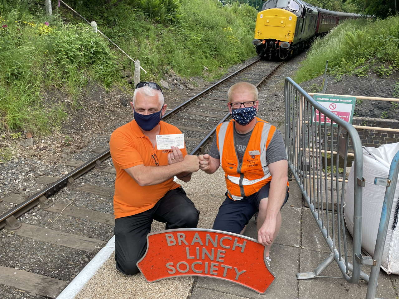 Kevin Adlam (right) presenting a cheque for 3000 to the Telford Steam Railway