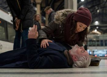 eve (sandra oh) and konstantin (kim bodnia) at liverpool st beside a greater anglia train from killing eve min