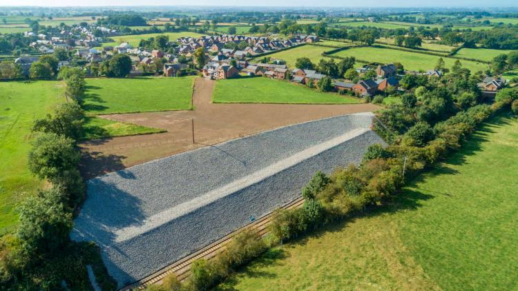 Drone shot showing the secured railway cutting at Cumwhinton