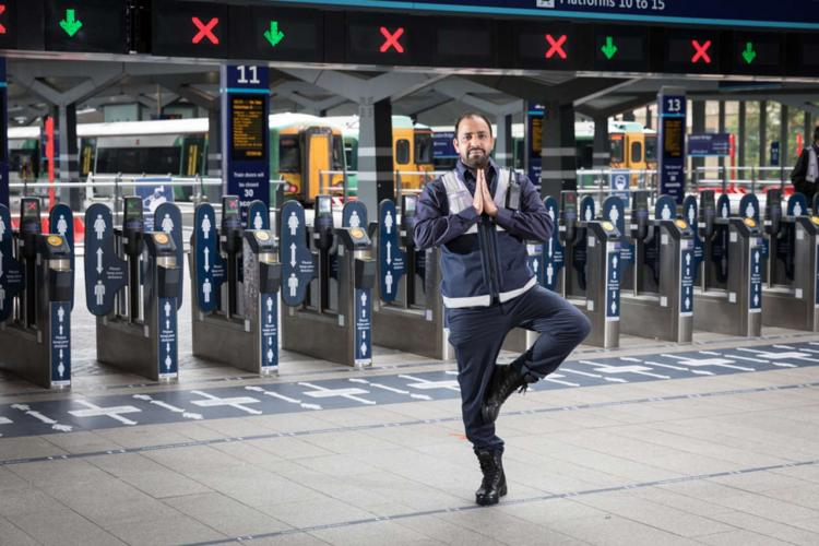 Station staff at Barrier in Tree Pose