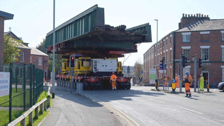 Warrington railway bridge being driven down street
