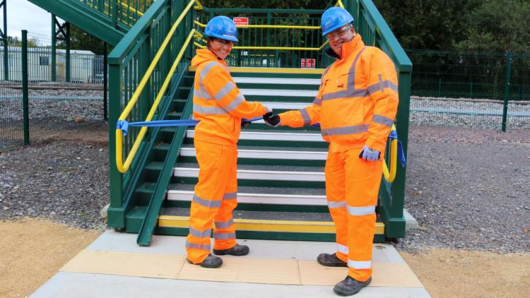 Alan Sheldon, NR Senior Programme Manager and Karen Wood, EWR Alliance Engineering Integration Manager officially opening new Jarvis Lane footbridge