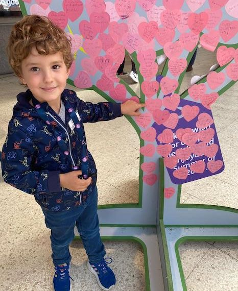 Five year old Amtek added his wish to be a train driver onto a wish tree