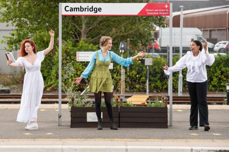 Actors celebrate the new partnership at Cambridge station