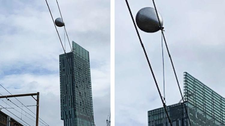 Helium balloon caught on overhead power lines on the Castlefield corridor in Manchester