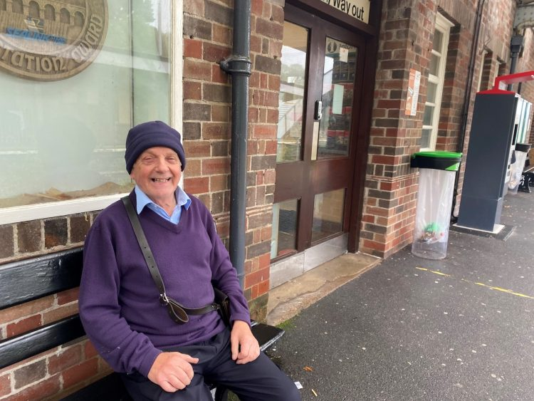 Jimmy sat on a platform bench