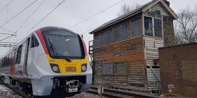 One of Greater Anglia's new trains at Hertford East next to the disused signal box
