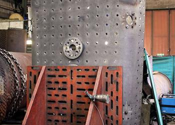 The outer face of the crown sheet clamped on to an angle plate showing one of the safety valve pads and a mudhole.